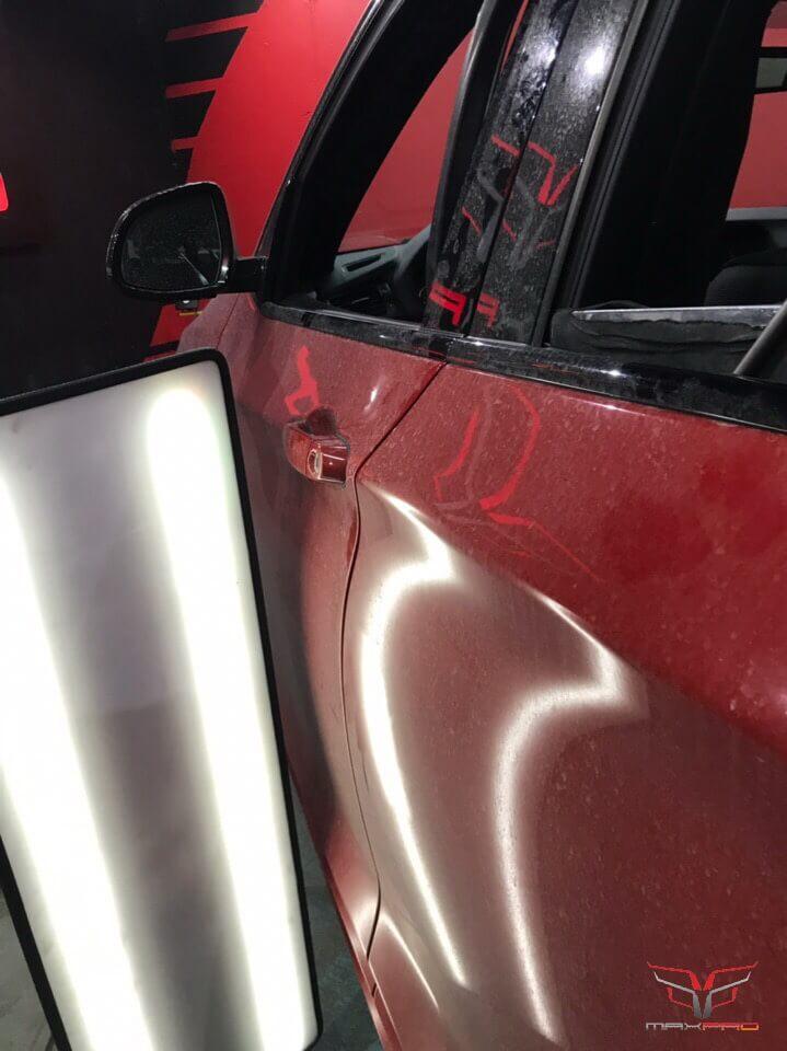 Результат удаления вмятины на двери